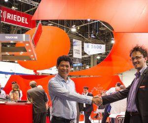riedel vietcoms partnership handshake